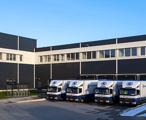 company headquarters of Hugo Hamann with 4 trucks